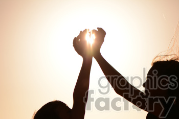 kids making heart silhouette with sun photo. Royalty-free photo # 391277