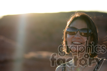 smiling female sunset photo. Royalty-free photo # 391292