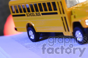 school bus on a book photo. Royalty-free photo # 391170