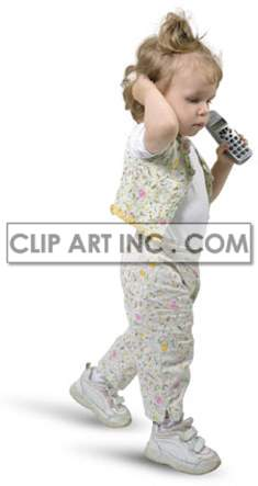 little girl holding a telephone while walking