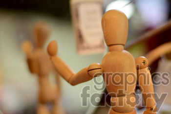 wooden posing character photo. Royalty-free photo # 391168
