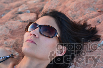 female laying on a rock clipart. Royalty-free image # 391288