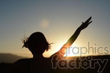 sunset with female arms raised photo. Royalty-free photo # 391276