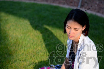 women sitting in the grass photo. Royalty-free photo # 391286