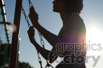 female on a swing during sunset clipart. Royalty-free image # 391274