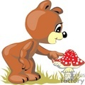 Teddy bear touching a red and withe mushroom