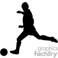 silhouette  of a guy kicking a ball