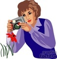 a woman photographer taking a picture of a red flower gif, jpg