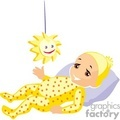 a baby in a yellow dotted sleeper laying on a pillow playing with a sun toy