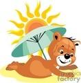 Teddy bear at the beach under an umbrella