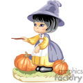 Little witch girl with pumpkins