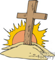 wooden cross with sun shining behind