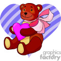 Teddy bear holding a pink heart