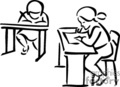 Two students at their desks in the classroom doing schoolwork