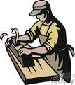 Carpenter using a wood planer