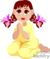 Little girl with brown hair and eyes praying on her knees