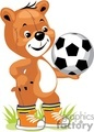 Teddy bear wearing orngae tennis shoes and holding a soccer ball