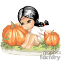 little girl sitting in a pumpkin patch
