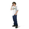 A Teenage Boy Standing while on His Cell Phone