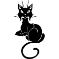 Black cat with curly tail laying down