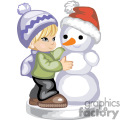 Cute little boy building a snowman with a carrot nose and a santa hat