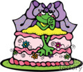 little girl frog sitting on top of a cake