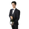 A Man in a Waiter Uniform Holding a Bottle Ready to Serve