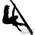 Silhouette of a person swinging on a pole